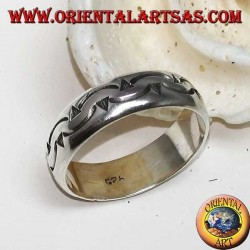 Silver ring with two rows of curved darts carved by hand