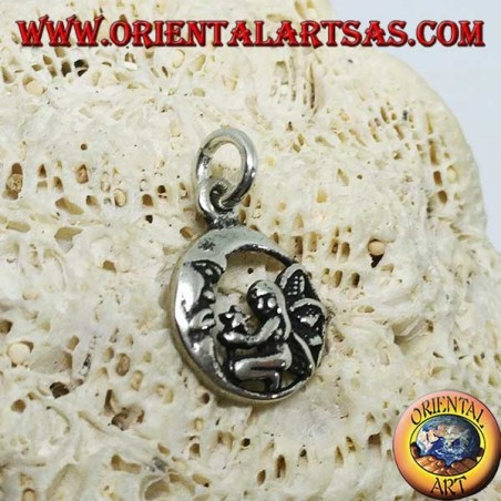 Silver fairy on her knees pendant that gives the star to the moon