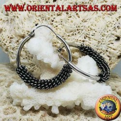 Silver hoop earrings twisted into a spiral