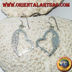 Hammered silver heart-shaped earrings with a striking face on the inside