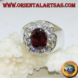 Silver ring with oval faceted garnet surrounded by brilliant cut zircons