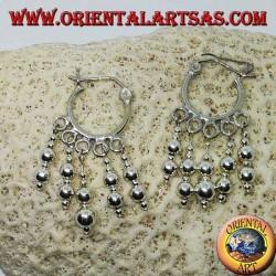 Silver hoop earrings with ball pendants