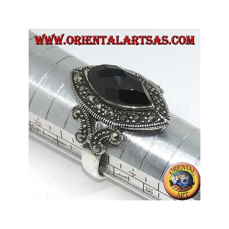 Silver ring with faceted shuttle onyx surrounded by marcasite