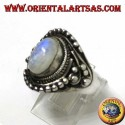 Silver ring with oval rainbow moonstone with asymmetrical ball decorations