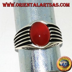 Silver ring with an oval cabochon carnelian and staves on the sides