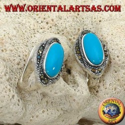 Silver lobe earrings with an oval turquoise surrounded by marcasites