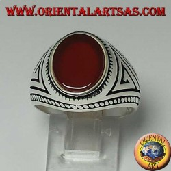 Silver ring with flat oval carnelian with braid at the edges of the ring