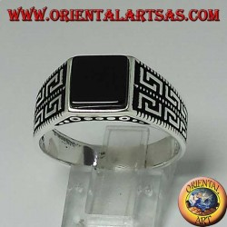 Silver ring with flat square onyx and two rows of Greek on the sides