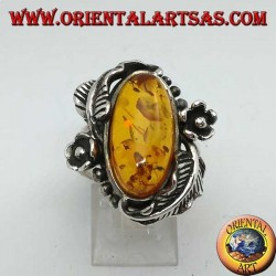 Silver ring with oval amber and floral decorations