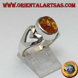 Silver ring with oval amber and openwork heart on the sides