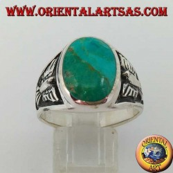 Silver ring with oval natural turquoise and low relief eagle on the sides (25)