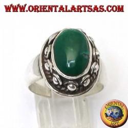 Bague en argent avec des clous autour du corps, de la turquoise antique naturelle ovale