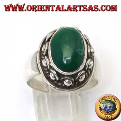 Silver ring with studs around the body, of the oval natural antique Turquoise