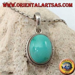 Silver pendant with oval natural turquoise and braided border
