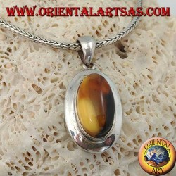 Silver pendant with oval natural Tibetan amber