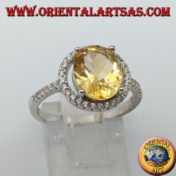 Silver ring with natural topaz suspended on a circle of zircons