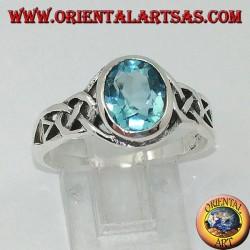 Серебряное кольцо с голубым топазом и кельтскими узлами по бокам