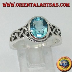 Silver ring with blue topaz and Celtic knots on the sides