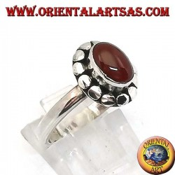 Silver ring with oval cabochon carnelian surrounded by studs