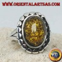 Silver ring with green oval amber surrounded by studs