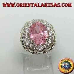 Silver ring with pink faceted oval pink zircon surrounded by brilliant cut zircons