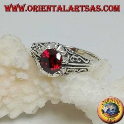 Inlaid silver ring with garnet-colored zircon set