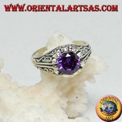 Inlaid silver ring with amethyst-colored zircon set