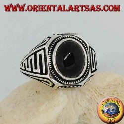 Silver ring with oval cabochon onyx and waves in bas-relief on the sides