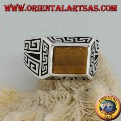 Silver ring with rectangular tiger's eye, surrounded by bas-relief Greek frets