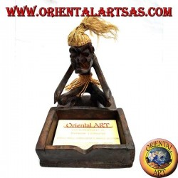 Business card holder with sculpture of a primitive man in teak wood