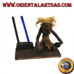 Pen holder with sculpture of a primitive man in teak wood