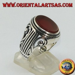 Silver ring with flat oval carnelian and a Lira (harp) carved on the sides