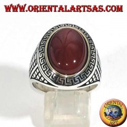 Silver ring with large oval carnelian surrounded by a Greek relief