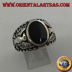 Silver ring with oval onyx and federal eagle in bas-relief on the sides