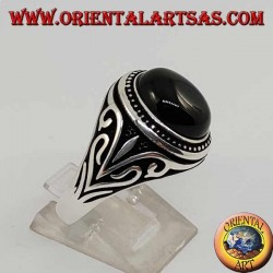Silver ring with oval cabochon onyx with side decorations