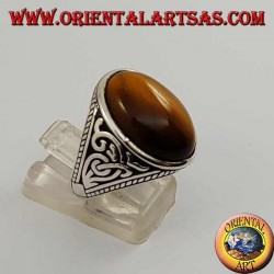Silver ring with oval tiger's eye and high relief decorations on the sides
