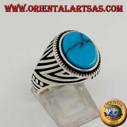 Silver ring with flat oval turquoise and engravings engraved on the sides
