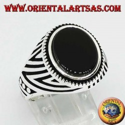 Silver ring with flat oval onyx and engravings engraved on the sides