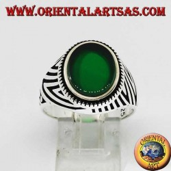 Silver ring with flat oval green agate and engravings engraved on the sides