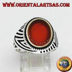 Silver ring with flat oval carnelian and engravings engraved on the sides