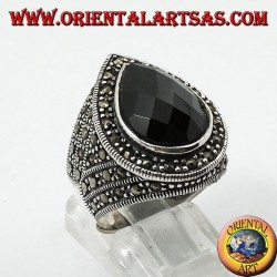 Silver ring with faceted teardrop onyx surrounded by marcasite
