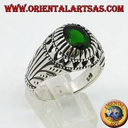 Silver ring with emerald-colored oval zircon set and carvings on the sides