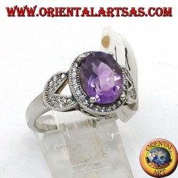 Silver ring with oval natural amethyst set surrounded by zircons
