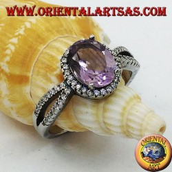 Silver ring with oval natural amethyst set with two rows of zircons on the sides