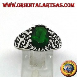Silver ring with oval emerald zircon and high relief decorations on the sides