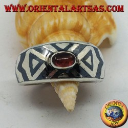 Rounded silver ring with oval garnet and niello decoration