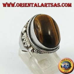 Silver ring with oval cabochon tiger's eye and Indian decorations