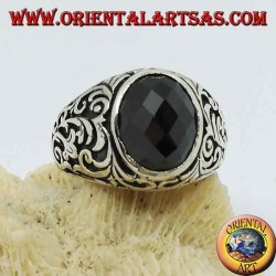 Silver ring with oval faceted onyx and floral engravings