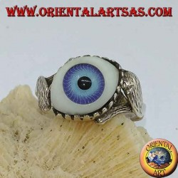 Silver ring with blue eye diagonally between two leaves
