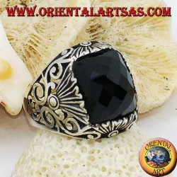 Silver ring with faceted rectangular onyx and openwork decorations